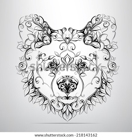 Head of bear in the ornament - stock vector