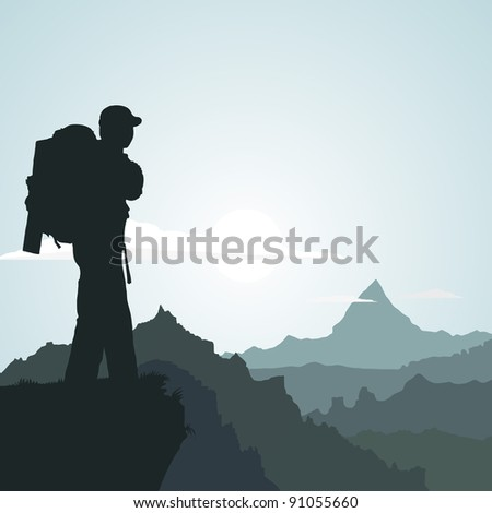 Hiking man with rucksack in mountain in the morning