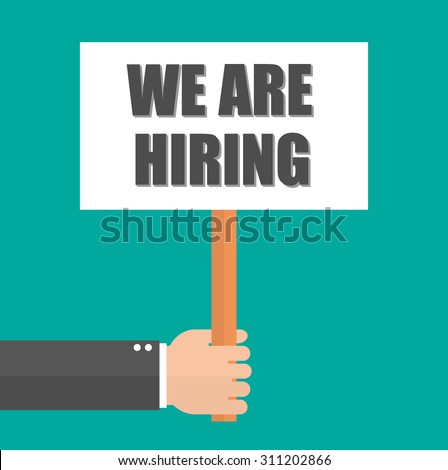 Hiring concept. Hand holding signboard with We are hiring text on it. Flat style - stock vector