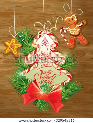 Holiday greeting Card with xmas gingerbread - man and star cartoons, candy and fir-tree branches. Hand written calligraphic text Merry Christmas and Happy New Year on wooden background.  - stock vector