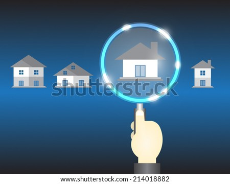 Home model and magnifier on dark background.