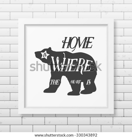 Hone is where the heart is - Quote typographical Background in realistic square white frame on the brick wall background. Vector EPS10 illustration.  - stock vector
