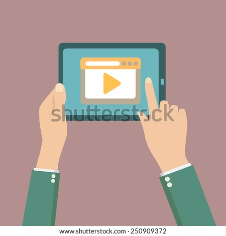Human hands holding tablet computer with video player on the scr - stock vector