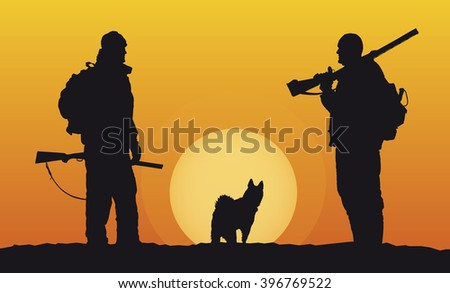 hunters with dog in the evening