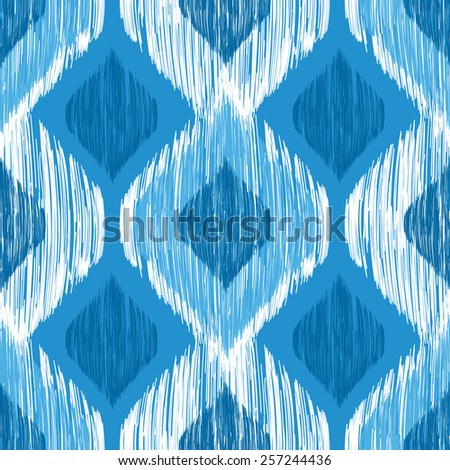 Ikat ethnic seamless pattern in blue and white colors - stock vector