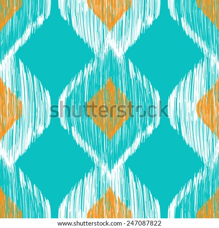 Ikat ethnic seamless pattern in blue and yellow colors - stock vector