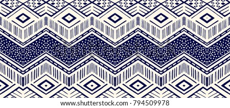 Ikat Geometric Folklore Ornament. Tribal Ethnic Vector Texture. Seamless  Striped Pattern In Aztec Style