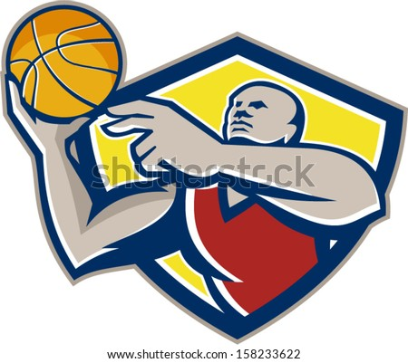 Illustration of a basketball player rebounding lay up ball set inside shield crest done in retro style.