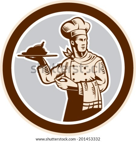 Illustration of a chef cook baker holding serving plate platter of whole chicken and towel hanging on the other hand set inside circle on isolated background done in retro style.