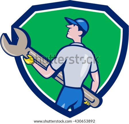 Illustration of a mechanic carrying giant spanner looking up to the side viewed from rear set inside shield crest on isolated background done in cartoon style.  - stock vector