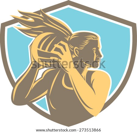 Illustration of a netball player catching rebounding ball looking to the side set inside shield crest on isolated background. - stock vector