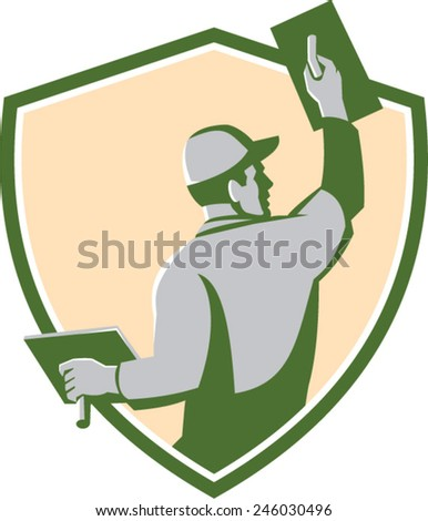 Illustration of a plasterer masonry tradesman construction worker with trowel viewed from the back set inside shield crest done in retro style on isolated background - stock vector