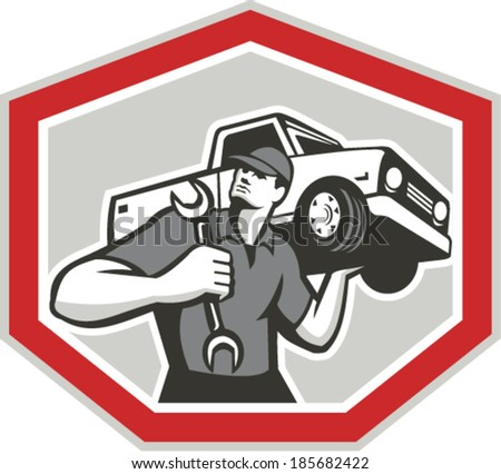 Illustration of an automotive mechanic carrying pick-up truck car vehicle on shoulder holding spanner wrench set inside shield crest shape done in retro style. - stock vector