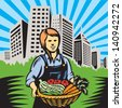 Illustration of woman female organic farmer holding basket of crop produce harvest of vegetables tomato carrots beans squash office building urban backdrop skyline  done in retro wpa woodcut style. - stock vector