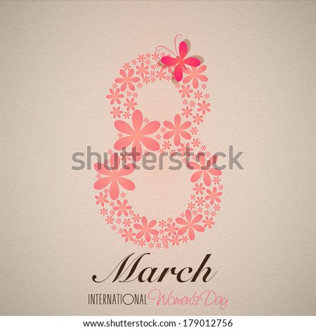 International Happy Women's Day celebration concept with stylish floral decorated text 8th March on brown background.