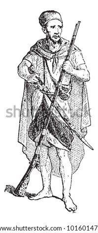 Kabyle, shown carrying a long rifle and sword, vintage engraved illustration. Dictionary of Words and Things - Larive and Fleury - 1895