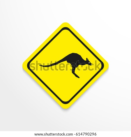 Kangaroo. Black and white image in yellow sign on a light background. Vector icon.