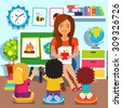 Kindergarten teacher woman teaching kids new words with picture cards. Children studying in classroom. Flat style cartoon vector illustration with isolated objects. - stock vector