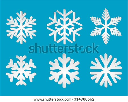 Kit isolated volume snowflakes over blue - stock vector