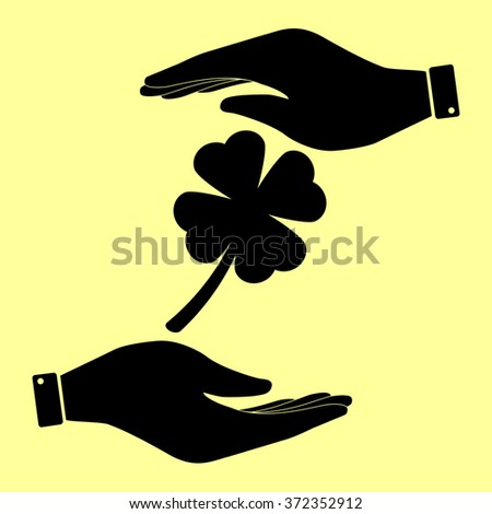 Leaf clover sign. Save or protect symbol by hands. - stock vector