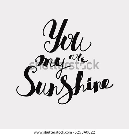 "Lettering ""You are my sunshine."" Uppercase letters, hand-drawing. Black letters on a light background."