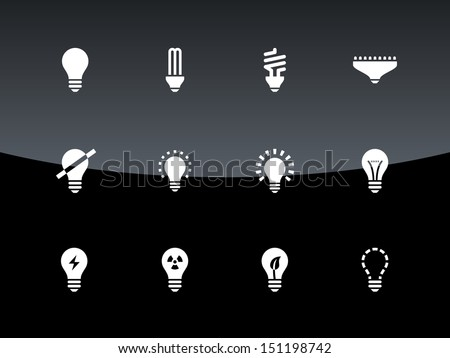 Light bulb and CFL lamp icons on black background. Vector illustration. - stock vector