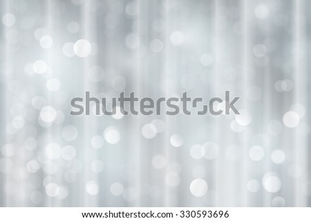 Light effects and sparkling out of focus lights for a magical abstract silver backdrop for the festive Christmas, holiday season to come. - stock vector