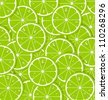 Lime slices with juice document background - stock photo