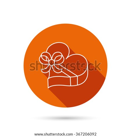 Love gift box icon. Heart with bow sign. Round orange web button with shadow. - stock vector