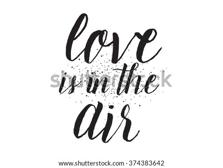 Love is in the air inscription. Greeting card with calligraphy. Hand drawn design. Black and white. Usable as photo overlay. - stock vector