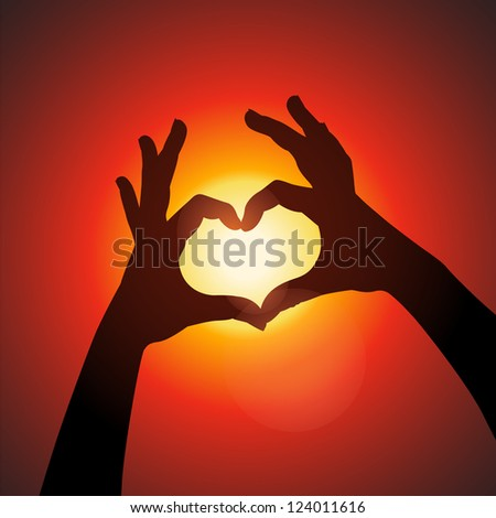 Love shape hands silhouette in sky