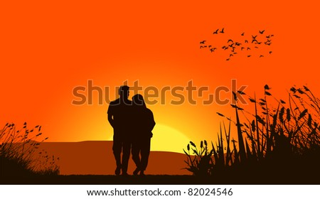 Loving couple against a sunset sky - stock vector