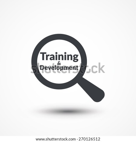 Magnifying glass with words training and development on white background - stock vector