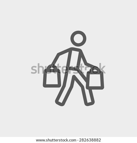 Man carrying shopping bags icon thin line for web and mobile, modern minimalistic flat design. Vector dark grey icon on light grey background. - stock vector