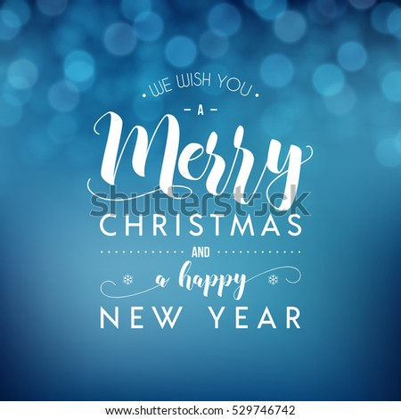 Merry Christmas and Happy New Year greeting card. Modern calligraphy lettering. Typographic vector design, beautiful blue bokeh background, blurred festive lights.