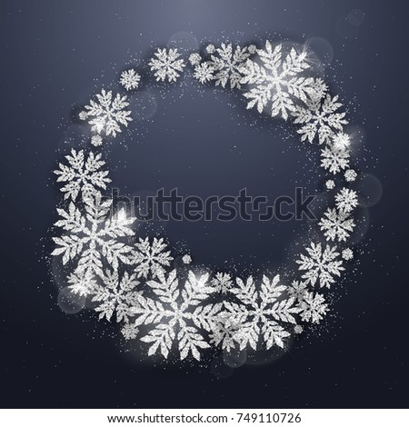 Merry Christmas and Happy New Year greeting card with silver glittering snowflakes round frame on dark blue background