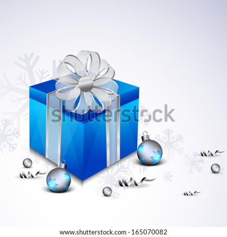 Merry Christmas celebration greeting card or invitation card with gift box wrapped in blue paper and ribbon.