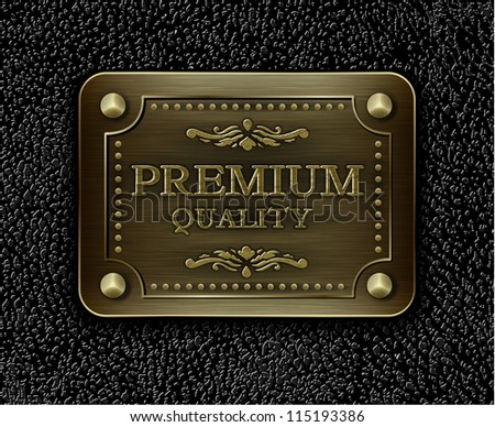 Metal badge on black leather background - eps10 illustration - stock vector