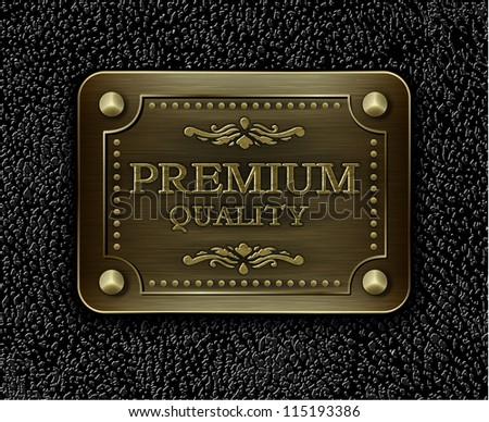 Metal badge on black leather background - eps10 illustration - stock vector