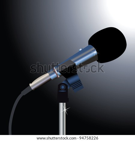 Microphone with a cord on a black background