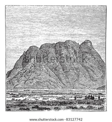 Mount Sinai or Mount Horeb or Mount Musa or Gabal Musa in Sinai Peninsula, Egypt, during the 1890s, vintage engraving. Old engraved illustration of Mount Sinai. Trousset encyclopedia (1886 - 1891). - stock vector