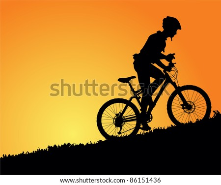 Mountain biker in sunset vector image - stock vector