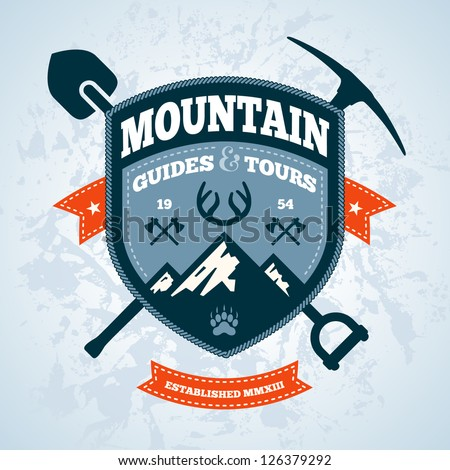 Mountain themed outdoors emblem logo with tools and axes