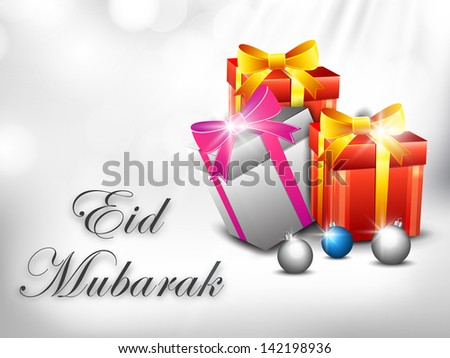 Muslim community festival Eid Mubarak background with gift boxes wrapped in ribbon on abstract grey background.