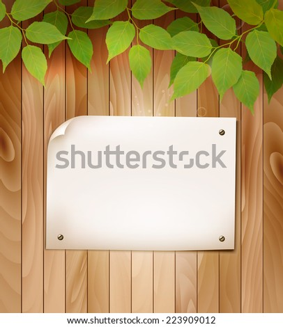 Natural wooden background with leaves and a blank piece of paper. Vector. - stock vector
