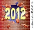 New Year 2012 breaking through red brick wall - stock photo