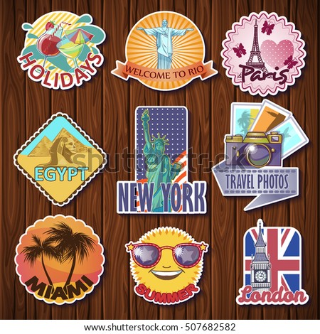 Nine isolated travel sticker designs with city sights statues towers symbols on a wooden table background