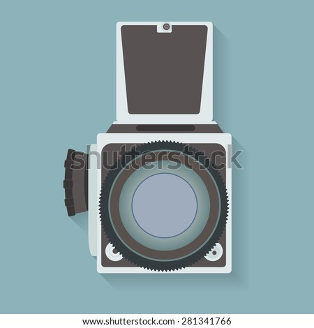 Old-fashioned photo camera on blue background. EPS10 vector illustration