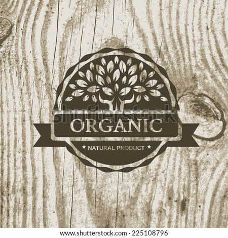 Organic product badge with tree on wooden texture. Vector illustration background. - stock vector