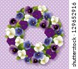 Pansy Wreath. Spring fresh garden flowers in purple, lavender, blue and white. White polka dots on pastel lavender background with copy space. EPS8 compatible. - stock vector